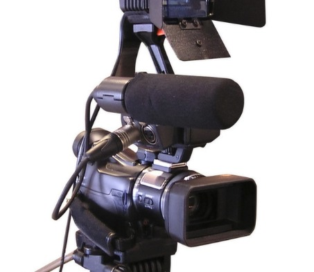 A camera with light and sound gear.